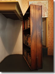 A Bookcase Swung Aside To Reveal Teh Hidden Staircase Up The Apartment Where Anne Frank