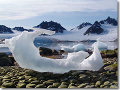 An eroded iceberg on a pebble beach on Spitsbergen, Svalbard, Norway.