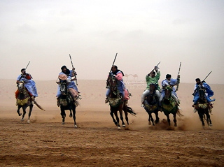 Berbers charge during a fantasia at the moussem de Tan-Tan, Morocco.