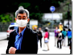 Wearing a mask to ward off air pollution