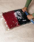 Compression bags for packing clothing