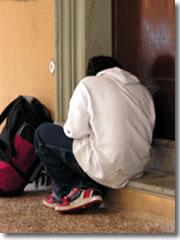 An addict in a doorway in Bolgona, Italy