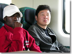 Though admittedly far from common yet, it's not unusual today to see people of all races and colors riding the trains in Europe.