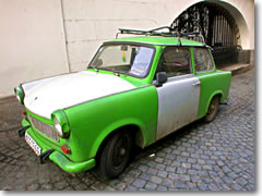 An East German Trabant parked on a cobblestone sidestreet in Prague