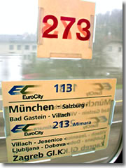Train car and line posters in the window of a European rail car