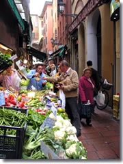 The street market on Via Drapperie in Bologna, Italy